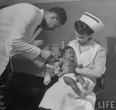 baby getting an immunization shot