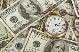 stopwatch in a pile of money