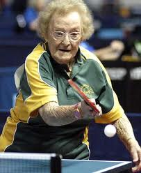 elderly lady playing ping pong