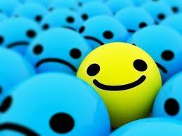smiley ball in sea of frowny balls