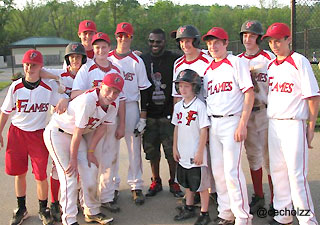 picture of brandon phillips with a team of young baseball players