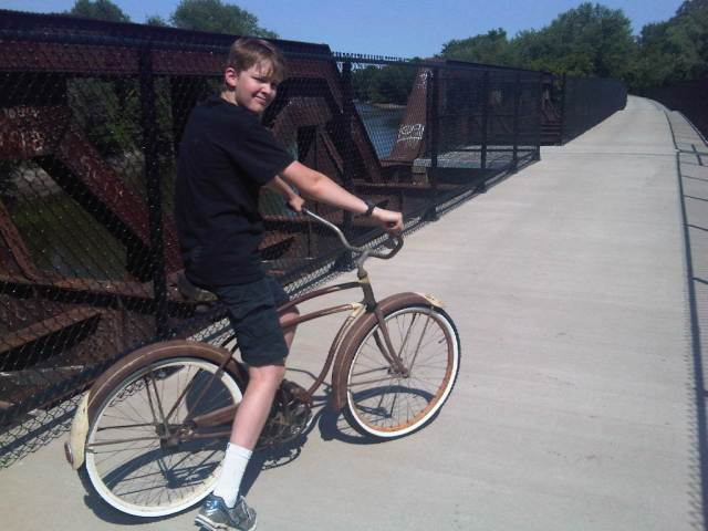 my son biking on the bike bridge (former railroad bridge)