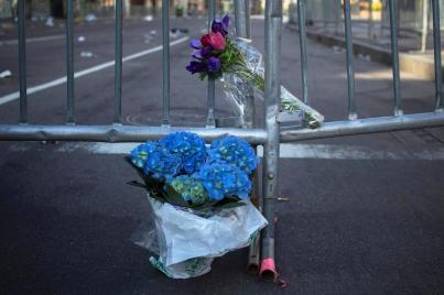 Flowers mark the barricaded entrance to Boylston Street near the finish line of the Boston Marathon in this photo from April 16. Two bombs packed with ball bearings tore through crowds near the race's finish line, killing three people and triggering a massive hunt for those behind the attack.